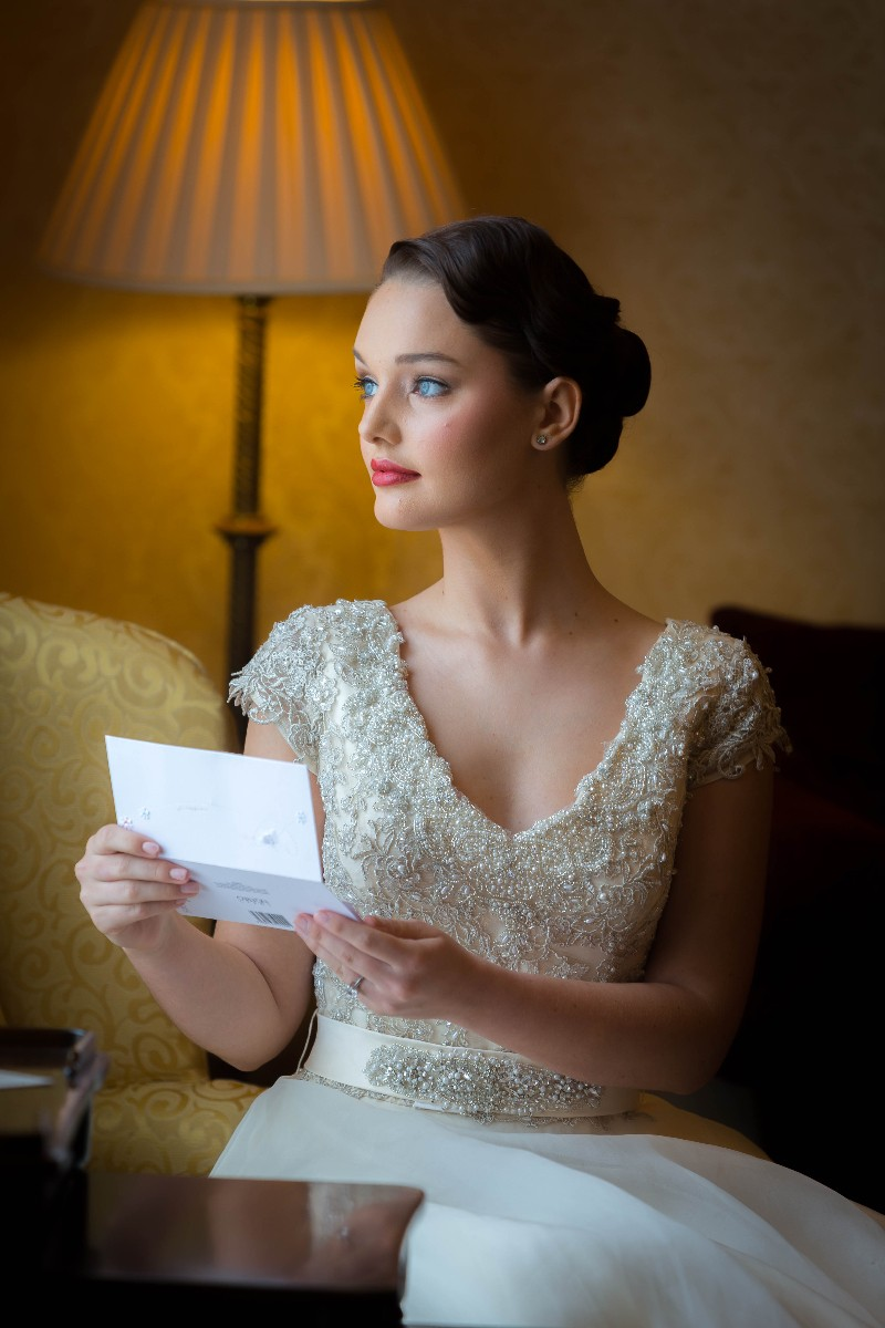 Bride in Library at Glenlo Abbey overlooking the Walled Garden
