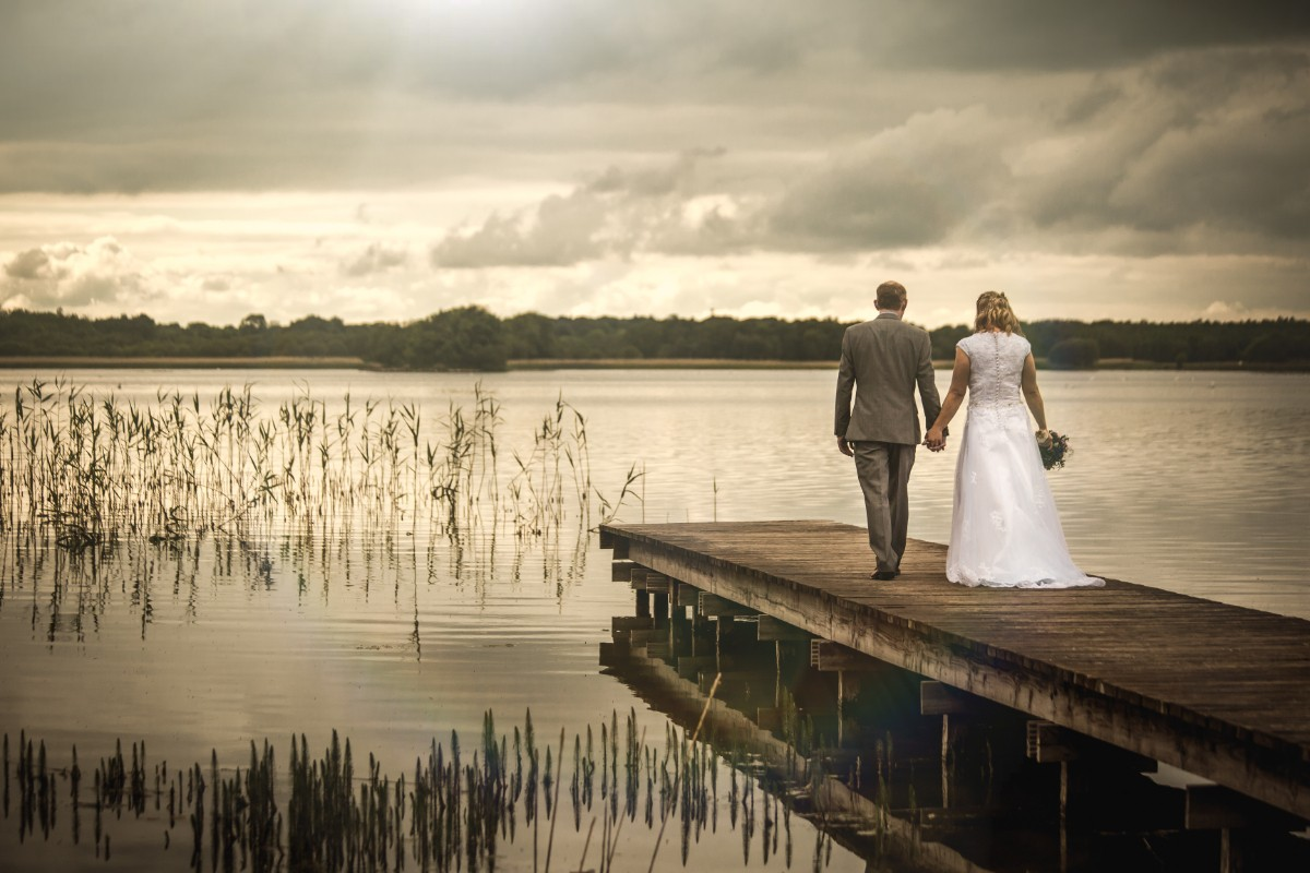 Bride and Groom walking down the Jetty at the Bloomfield Hotel Wedding Venue
