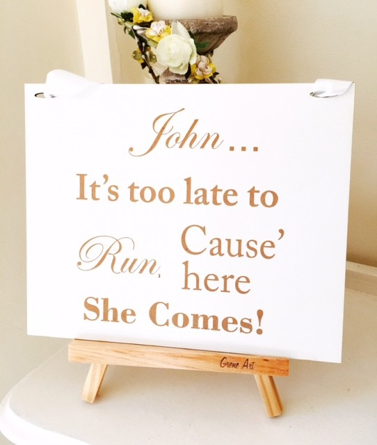It's too late to run cause here she comes - Page Boy Sign