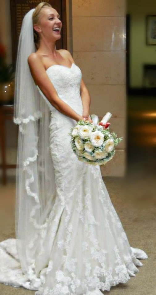 Our beautiful bride having lots of fun on her wedding day.