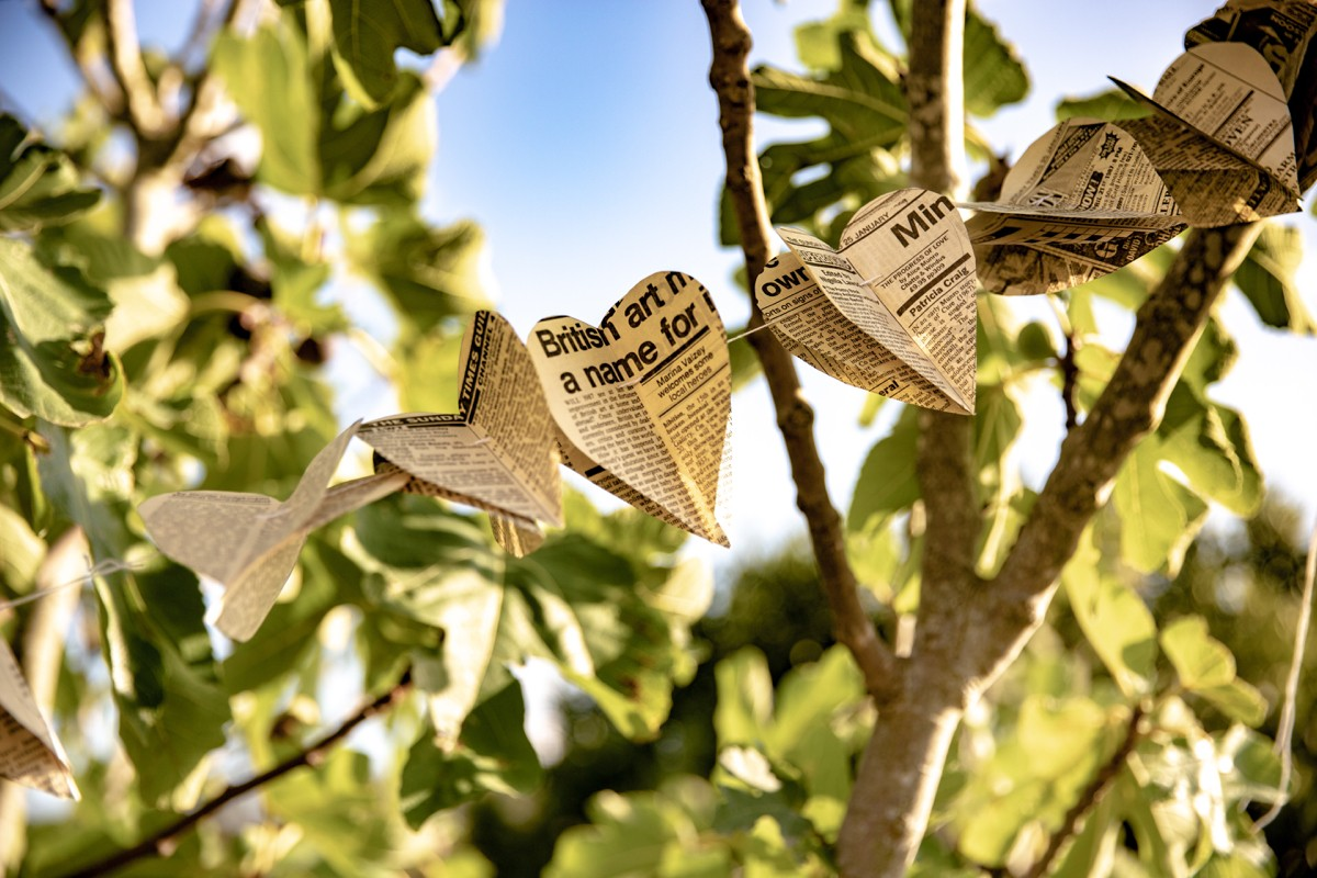 rustic wedding decor paper hearts in the fig tree