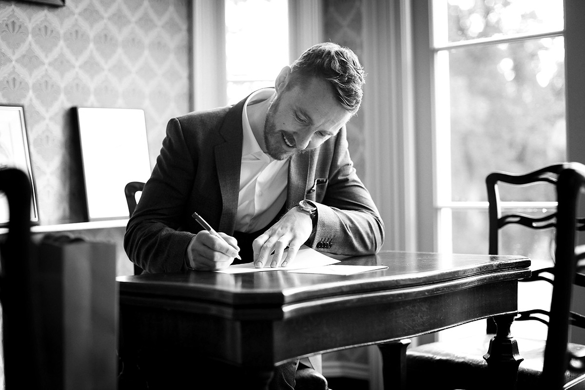 Groom writing letter to Bride, real wedding, documentary style, natural, reportage, candid, black and white,