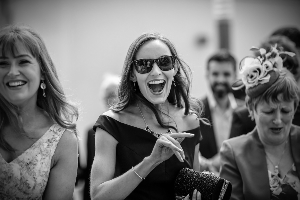 sunglasses, little black dress, wedding guests having fun, real wedding, documentary style, natural, reportage, candid, black and white,
