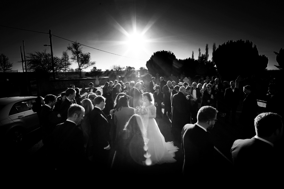 Backlit kiss, romantic, sunshine, silhouette, real wedding, documentary style, natural, reportage, candid, black and white,