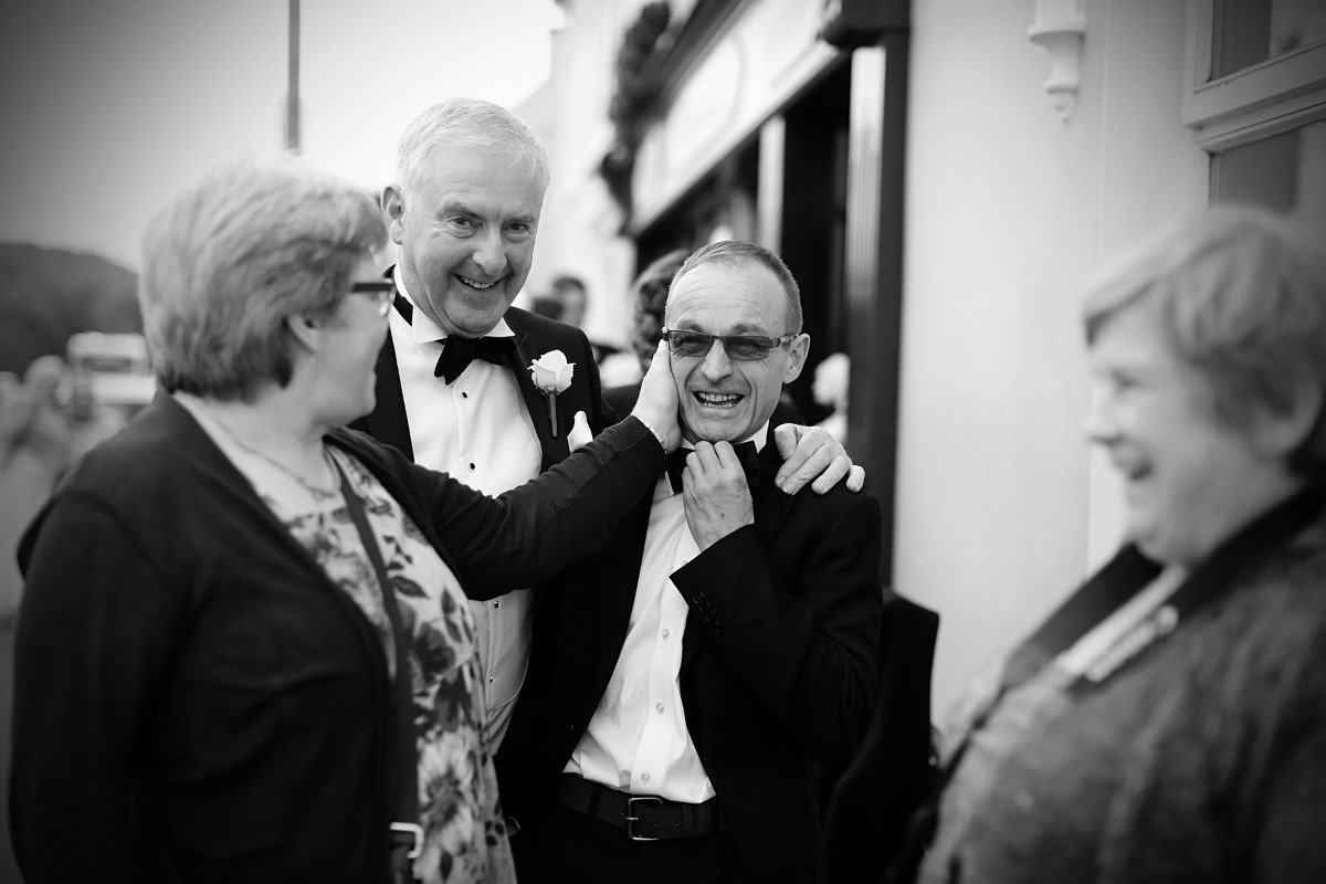 Wedding guest teasing, wedding guest fun, black tie wedding reportage, real wedding, documentary style, natural, reportage, candid, black and white,