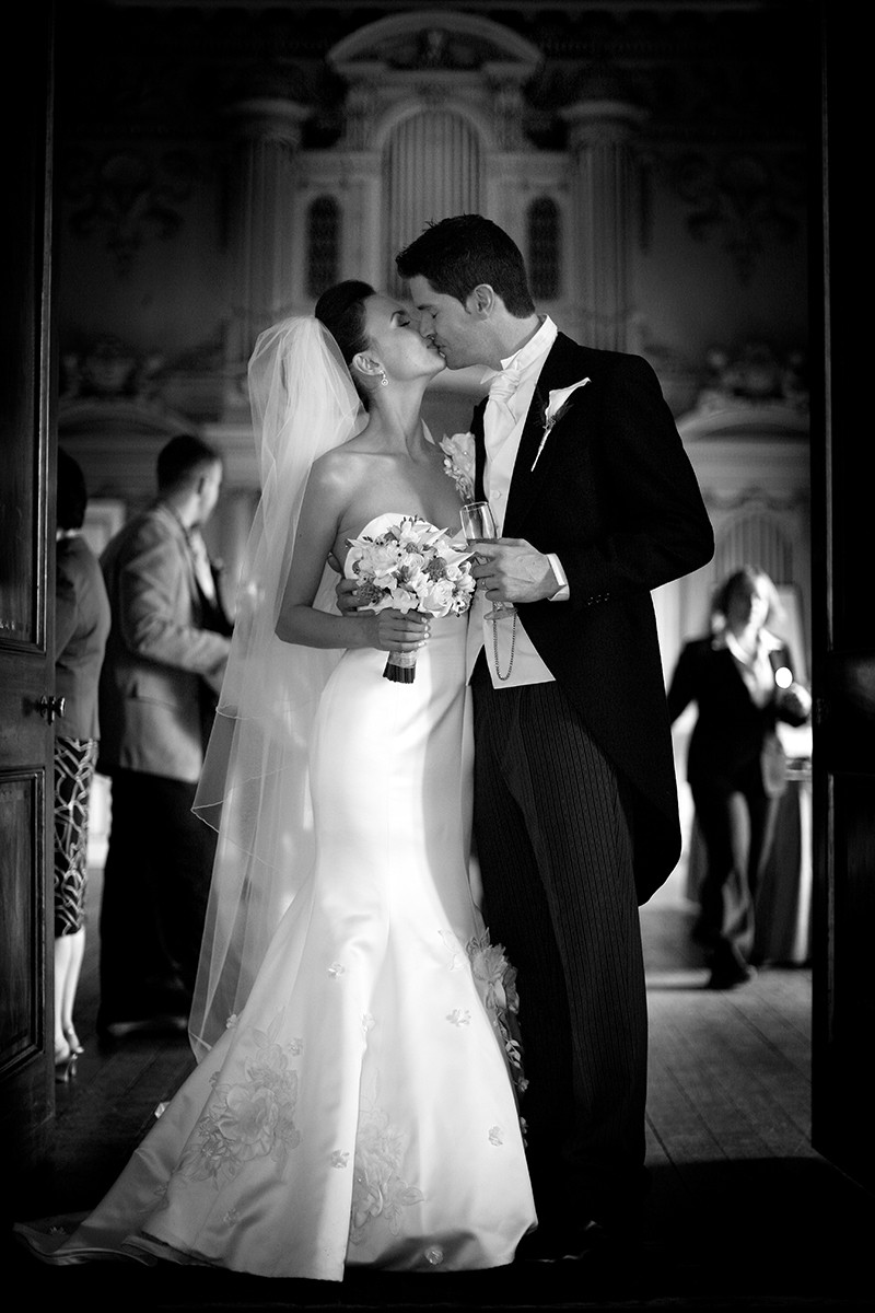 Bride and Groom Kiss, romantic, fishtail dress, black tie, tails, veil, real wedding Carton House, documentary style, natural, reportage, candid, black and white,