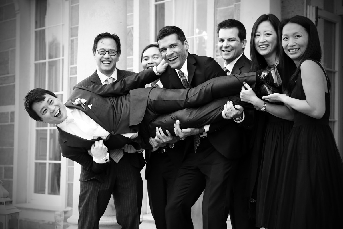 Groom lifted by friends, black and white, real wedding, Carton House, wedding fun, Natural documentary style, asian Groom wedding ireland