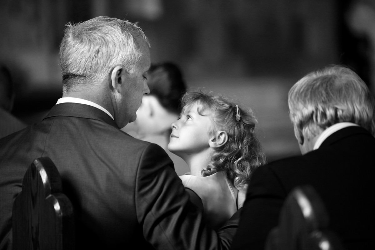 loving moment between father and daughter, documentary style, natural, reportage, candid, black and white, wedding reportage
