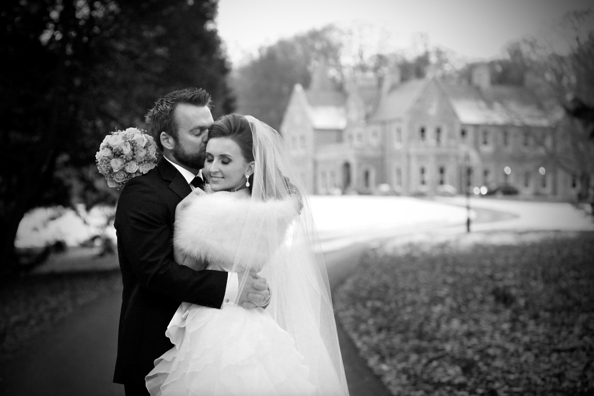Snowy wedding, couple in snow, real wedding at Mount Falcon, natural, black and white,