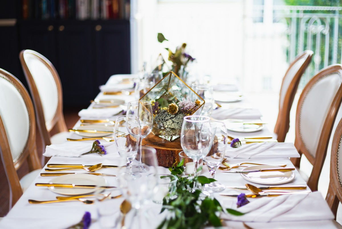 Indoor wedding guest table setting at The Avon Lakeshore Wedding Venue in The Library Bar/Room