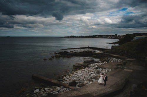 seaside, weddinng, photography, bride, groom, sky, clouds, dublin, royal, marine, hotel, moody, natural, modern