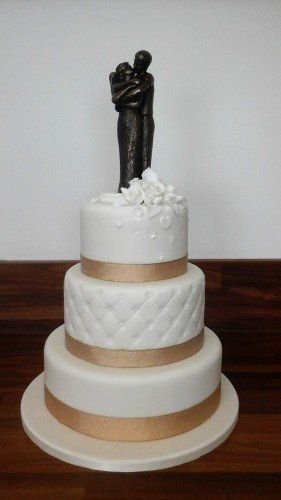 Wedding Cakes Sligo - www.cakerise.ie White 3 Tier cake with Gold ribbon trim and Bronze statue cake topper.