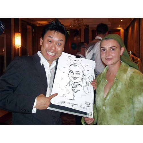 Me and a certain Irish Singer!  Caricatures by Mark Heng-  Drawing Smiles since 1990!