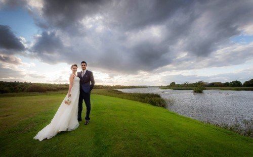 Bride & Groom by Lough Corrib on the grounds of Glenlo Abbey Hotel & Estate