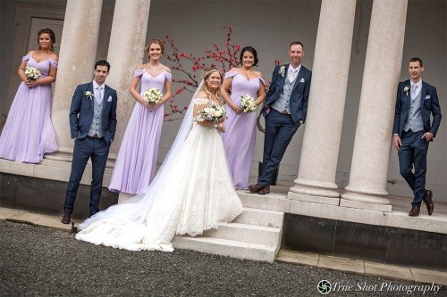 Bride, Groom and wedding party outside Carton House