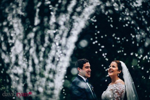Bride & Groom at the fountain in the garden