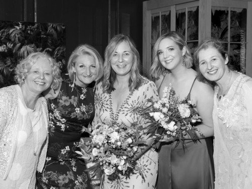 Bride with sisters and daughter