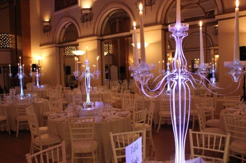 Chiavari Chairs With Clear Candelabra Lit In Purple Light