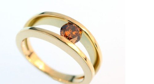 Orange diamond solitaire in yellow gold