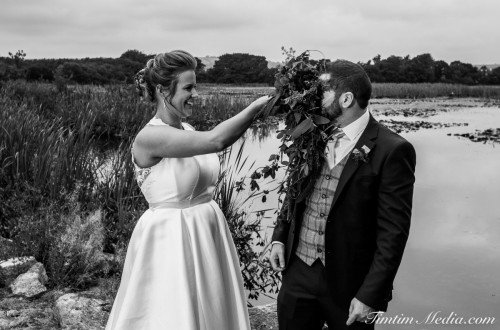 Bride and Groom pose for a funny portrait on their wedding day in Co Cork