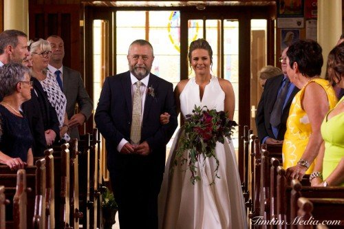 Bride and her father walking down the isle on her wedding day in Cork Ireland
