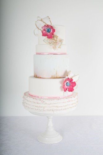 Elegant Wedding Cake with large floral detail & love letters.