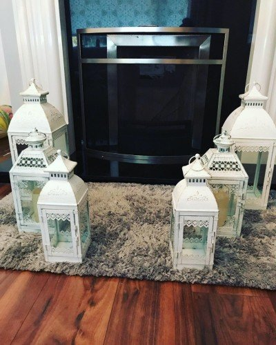 6 white lanterns with candles