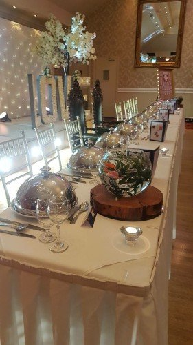 Top Table Layout with our rustic wooden logs and fish bowls / Hotel Wedding Venues | Great National Abbey Court Hotel