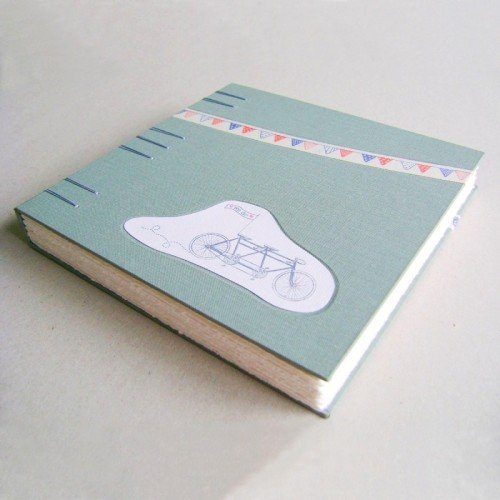 Handmade guest book with image from wedding invite on cover