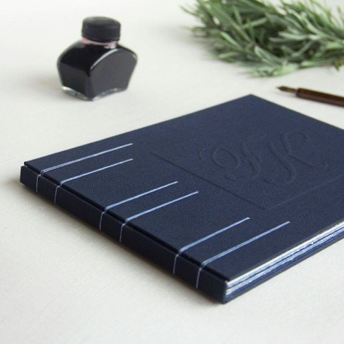 Handmade guest book with initials of couple on cover