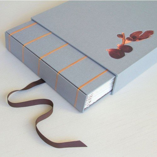 Handmade wedding album with slipcase box with fig motif from invites