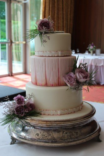 3 Tier Ivory/Pink & a hint of gold.  Wood effect middle tier with fresh flowers for decoration.  Sligo Park Hotel reception.