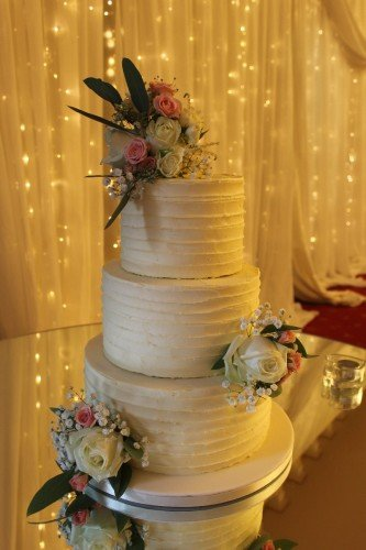 3 Tier Butter cream cake with fresh flowers at beautiful Kilronan Castle.