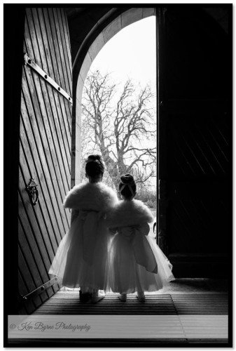 Natural wedding photography of children at the church. Castletown Geoghegan, Castletown, Co. Westmeath