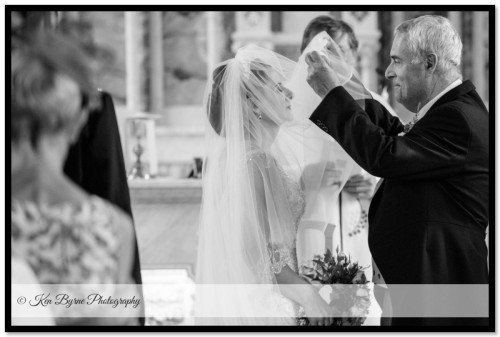 Dad lifting the brides veil during the wedding ceremony