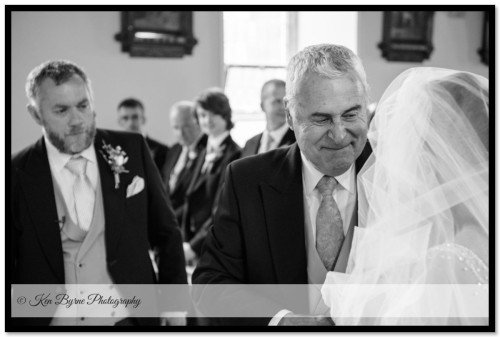 Dad reaction as he hands over his daughter to the groom at the wedding ceremony