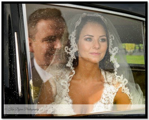 Reflections in the wedding car window between the bride and groom at Glasson Lakehouse, Killinure, Glasson, Co. Westmeath