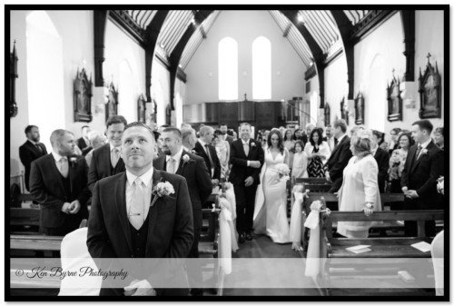 Grooms reaction waiting for the bride  at the wedding ceremony Ballymagarvey Village, Ballymagarvey, Balrath, Co. Meath