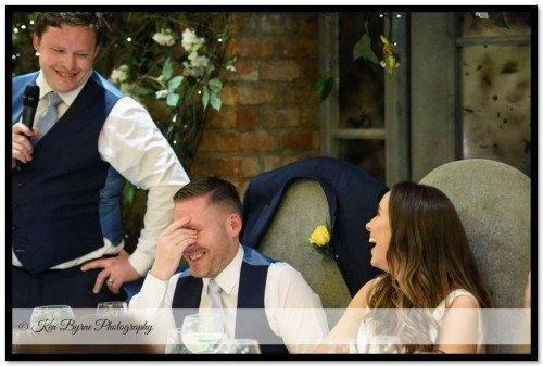 Candid bride and groom reactions during speeches on the  wedding evening. Ballymagarvey Village, Ballymagarvey, Balrath, Co. Meath