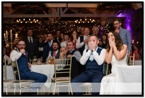 Candid bride and groom reactions during the same day slideshow on the  wedding evening. Ballymagarvey Village, Ballymagarvey, Balrath, Co. Meath