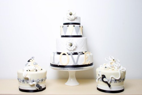 """LOVE"" Wedding Cake with matching satalite single tier cakes"