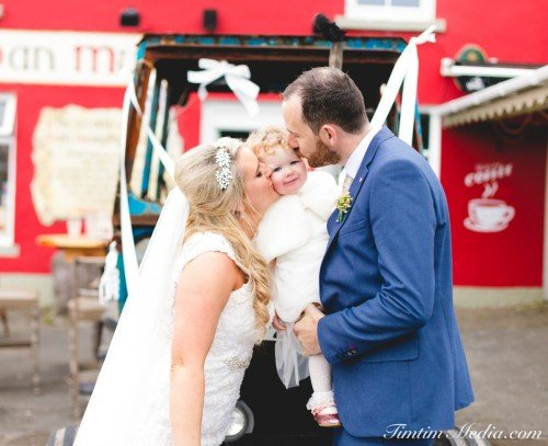 Bride and Groom with their daughter in Sneem Co Kerry on their Wedding day