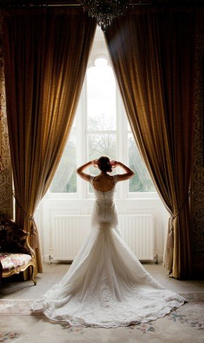Cabra Castle, bride, train, window light, pose, wedding dress, - Janet Meehan Photography