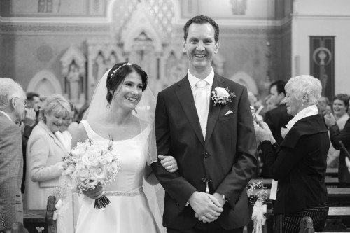 carol dunne photography wedding photography couple bride and groom happy love relaxed natural documentary photography church ceremony aisle just married
