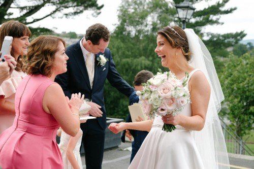 carol dunne photography wedding photography couple bride and groom happy love relaxed natural documentary photography laughter friends guests