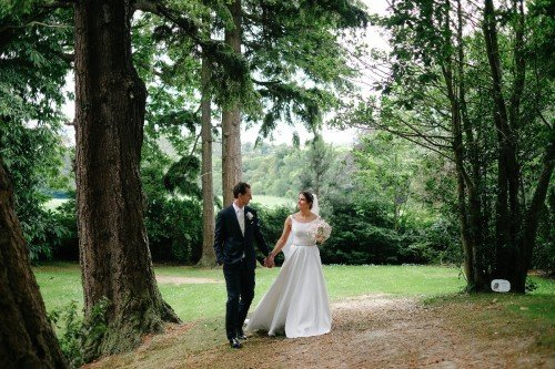 carol dunne photography wedding photography couple bride and groom happy love woods forest walking time together natural relaxed