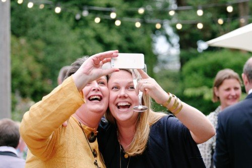 carol dunne photography wedding photography couple bride and groom happy love selfie guests enjoyment laughter fun fly on the wall