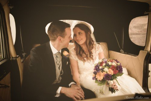 Bride and groom  in the wedding car on their wedding day in Co  Cork Ireland