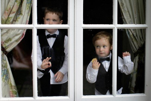 pageboys caught unawares, pageboys through window, real wedding Marlfield house, blacktie pageboys