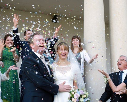 confetti shot with bride and groom, real wedding Carton House, guests throwing confetti,